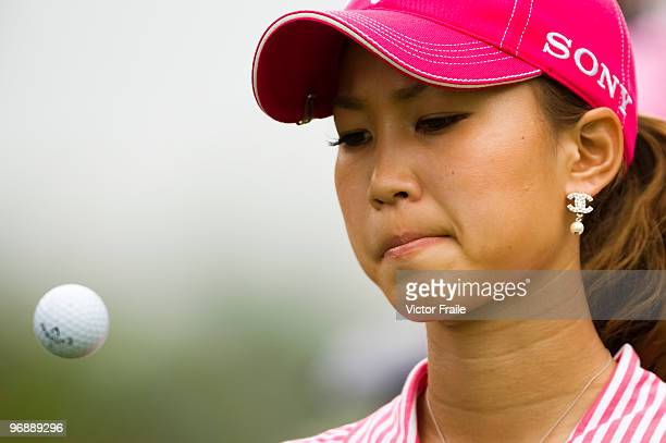Momoko Ueda of Japan reacts to a putt on the 5th green during round three of the Honda PTT LPGA Thailand at Siam Country Club on February 20 2010 in...