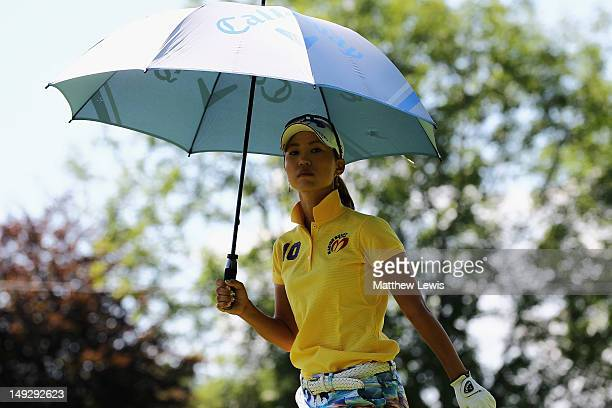 Momoko Ueda of Japan shelters from the heat during day one of the Evian Masters at the Evian Masters Golf Club on July 26 2012 in EvianlesBains France