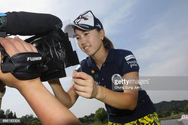 Momoko Ueda of Japan signs an autograph on the TV camera after winning the Chukyo Television Bridgestone Ladies Open at the Chukyo Golf Club Ishino...