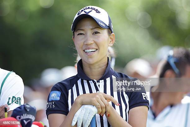 Momoko Ueda of Japan smiles on the third hole during the final round of the 48th LPGA Championship Konica Minolta Cup 2015 at the Passage Kinkai...