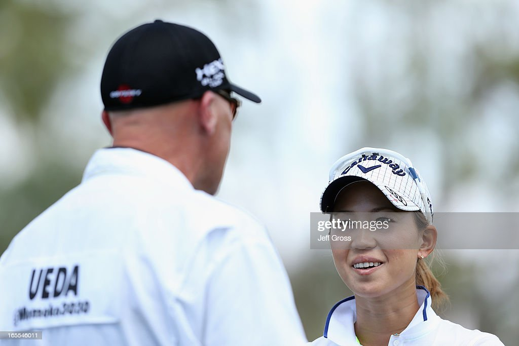 <a gi-track='captionPersonalityLinkClicked' href=/galleries/search?phrase=Momoko+Ueda&family=editorial&specificpeople=3990725 ng-click='$event.stopPropagation()'>Momoko Ueda</a> of Japan talks with her caddie on the 11th tee box during the first round of the Kraft Nabisco Championship at Mission Hills Country Club on April 4, 2013 in Rancho Mirage, California.