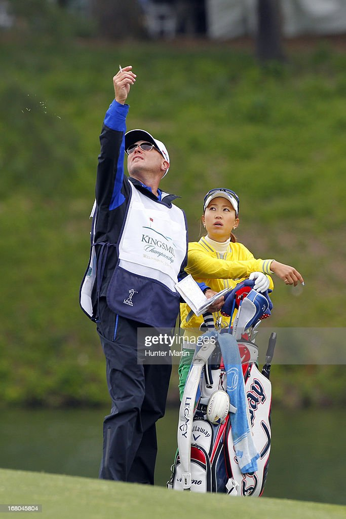 <a gi-track='captionPersonalityLinkClicked' href=/galleries/search?phrase=Momoko+Ueda&family=editorial&specificpeople=3990725 ng-click='$event.stopPropagation()'>Momoko Ueda</a> of Japan watches her caddie test he wind on the 18th hole during the third round of the Kingsmill Championship at Kingsmill Resort on May 4, 2013 in Williamsburg, Virginia.