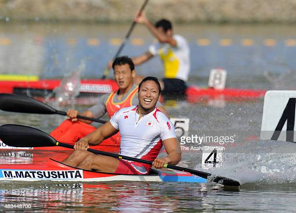 Momotaro Matsushita of Japan celebrates winning the gold medal after the Canoe Sprint Men's Kayak Single 200m during the day fourteen of the...