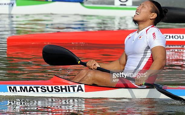 Momotaro Matsushita of Japan reacts after winning the men's kayak 200m final at the 16th Asian Games in Guangzhou on November 26 2010 Japan won gold...