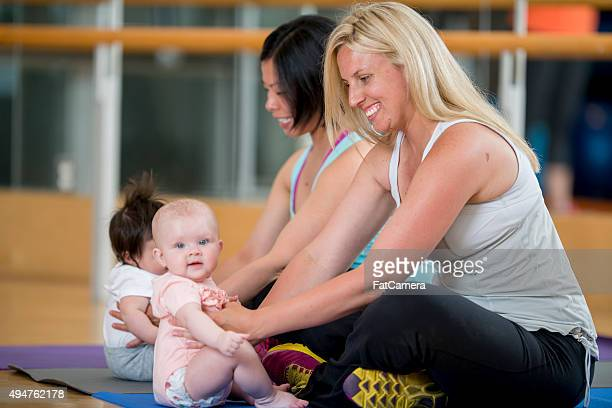 Moms Playing with Toddlers During an Exercise Class