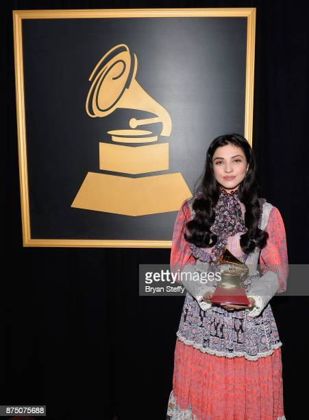 Mon Laferte winner of the Best Alternative Song award for 'Amarrame' attends the Premiere Ceremony during the 18th Annual Latin Grammy Awards at the...