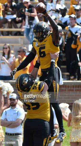 Mon Moore of the Missouri Tigers celebrates his touchdown with offensive lineman Trystan Castillo during a game Missouri State Bears in the second...