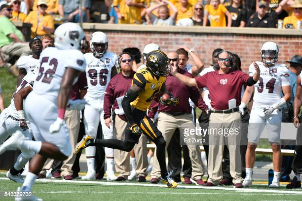 Mon Moore of the Missouri Tigers runs against the Missouri State Bears at Memorial Stadium on September 2 2017 in Columbia Missouri
