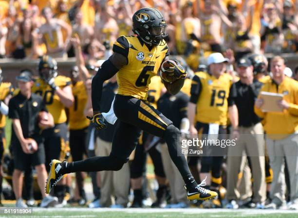 Mon Moore of the Missouri Tigers runs for a touchdown against the Missouri State Bears in the second quarter at Memorial Stadium on September 2 2017...