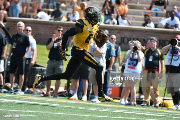 Mon Moore of the Missouri Tigers runs for a touchdown against the Missouri State Bears at Memorial Stadium on September 2 2017 in Columbia Missouri