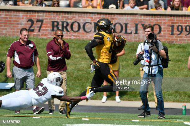Mon Moore of the Missouri Tigers runs linebacker McNeece Egbim of the Missouri State Bears at Memorial Stadium on September 2 2017 in Columbia...