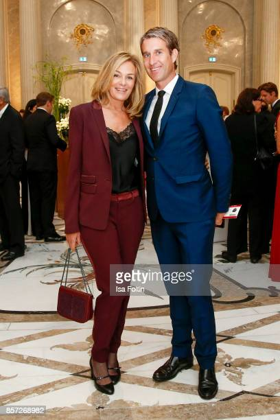 Mon Muellerschoen and her husband Oliver Fritz during the ReOpening of the Staatsoper Unter den Linden on October 3 2017 in Berlin Germany
