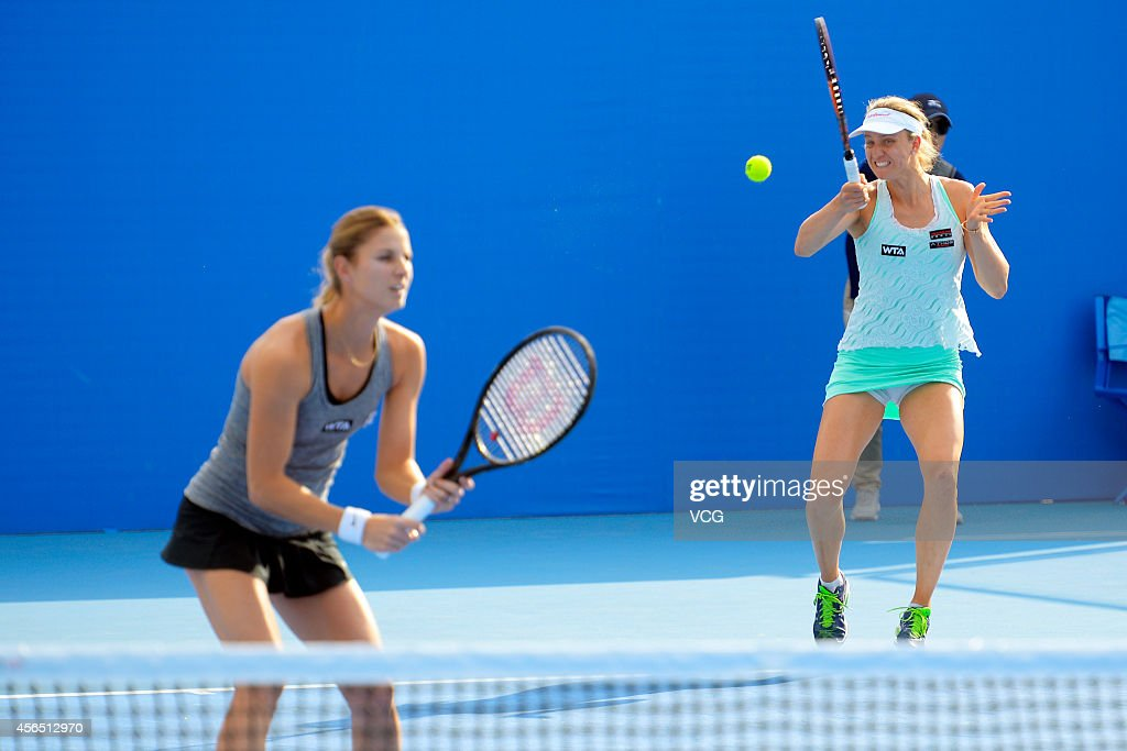 <a gi-track='captionPersonalityLinkClicked' href=/galleries/search?phrase=Mona+Barthel&family=editorial&specificpeople=7794496 ng-click='$event.stopPropagation()'>Mona Barthel</a> of Germany and <a gi-track='captionPersonalityLinkClicked' href=/galleries/search?phrase=Mandy+Minella&family=editorial&specificpeople=3378502 ng-click='$event.stopPropagation()'>Mandy Minella</a> of Luxembourg compete with Alla Kudryavtseva of Russia and Anastasia Rodionova of Australia at National Tennis Centre in day 6 of 2014 China Open on October 2, 2014 in Beijing, China.