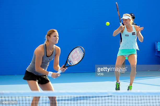 Mona Barthel of Germany and Mandy Minella of Luxembourg compete with Alla Kudryavtseva of Russia and Anastasia Rodionova of Australia at National...