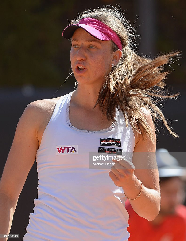 <a gi-track='captionPersonalityLinkClicked' href=/galleries/search?phrase=Mona+Barthel&family=editorial&specificpeople=7794496 ng-click='$event.stopPropagation()'>Mona Barthel</a> of Germany celebrates a point against Maria-Teresa Torro-Flor of Spain during qualifying for the Internazionali BNL d'Italia 2014 on May 10, 2014 in Rome, Italy.