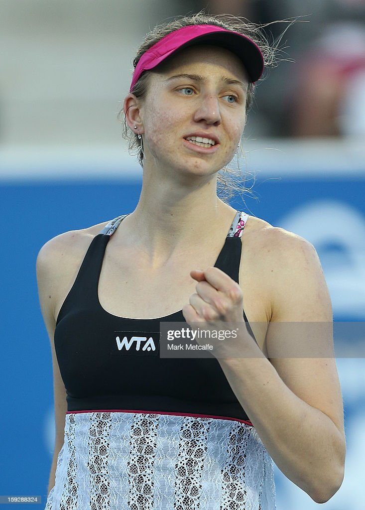 <a gi-track='captionPersonalityLinkClicked' href=/galleries/search?phrase=Mona+Barthel&family=editorial&specificpeople=7794496 ng-click='$event.stopPropagation()'>Mona Barthel</a> of Germany celebrates winning match point in her semi final match against Kirsten Flipkens of Belgium during day eight of the Hobart International at Domain Tennis Centre on January 11, 2013 in Hobart, Australia.