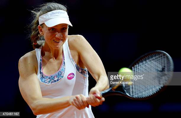 Mona Barthel of Germany hits a backhand during her first round match against Carina Witthoeft of Germany on day one of the Porsche Tennis Grand Prix...
