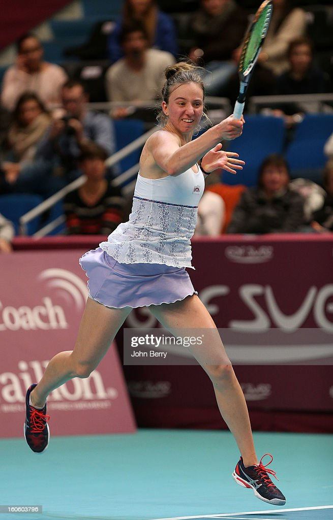 <a gi-track='captionPersonalityLinkClicked' href=/galleries/search?phrase=Mona+Barthel&family=editorial&specificpeople=7794496 ng-click='$event.stopPropagation()'>Mona Barthel</a> of Germany in action against Sara Errani of Italy during the final of the Open GDG Suez 2013 at the Stade Pierre de Coubertin on February 3, 2013 in Paris, France.