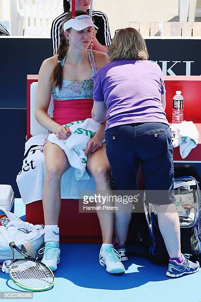 Mona Barthel of Germany is seen by a doctor during her first round match against Svetlana Kuznetsova of Russia during day one of the 2016 ASB Classic...