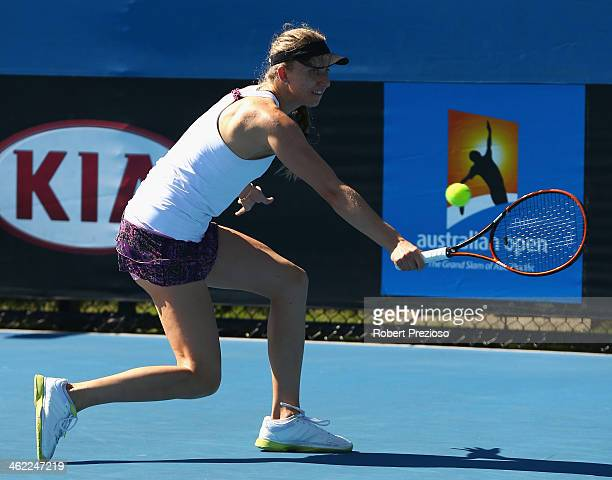 Mona Barthel of Germany plays a backhand in her first round match against Shuai Zhang of China during day one of the 2014 Australian Open at...
