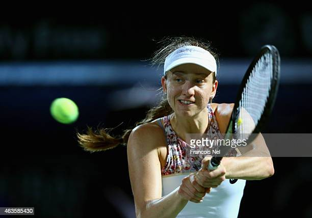Mona Barthel of Germany plays a backhand in her match against Daniela Hantuchova of Slovakia during day two of the WTA Dubai Duty Free Tennis...