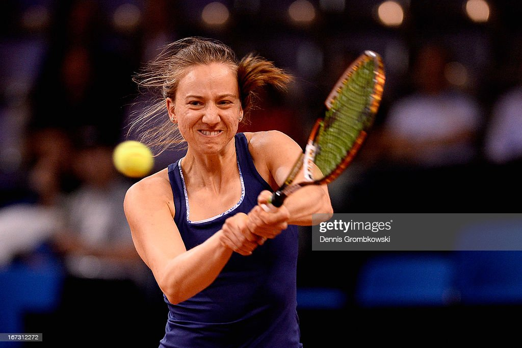<a gi-track='captionPersonalityLinkClicked' href=/galleries/search?phrase=Mona+Barthel&family=editorial&specificpeople=7794496 ng-click='$event.stopPropagation()'>Mona Barthel</a> of Germany plays a backhand in her match against Lucie Safarova of Czech Republic during Day 3 of the Porsche Tennis Grand Prix at Porsche-Arena on April 24, 2013 in Stuttgart, Germany.