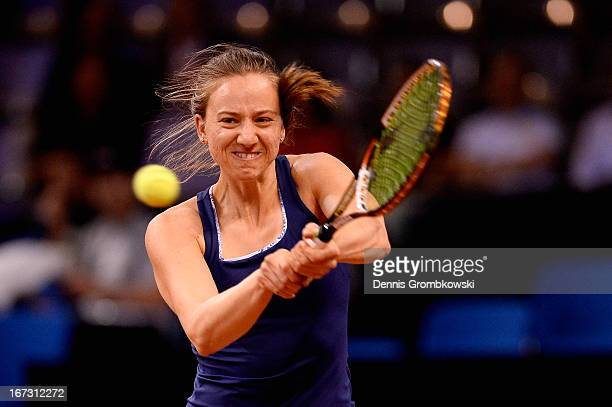 Mona Barthel of Germany plays a backhand in her match against Lucie Safarova of Czech Republic during Day 3 of the Porsche Tennis Grand Prix at...