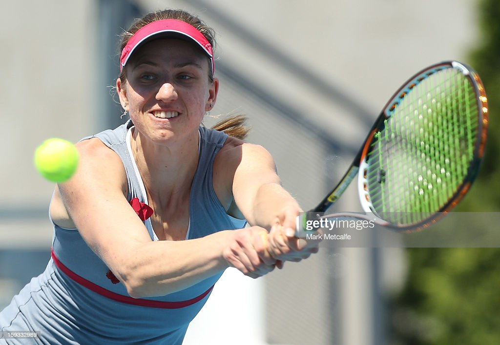 Mona Barthel of Germany plays a backhand in her singles final match against Elena Vesnina of Russia during day nine of the Hobart International at Domain Tennis Centre on January 12, 2013 in Hobart, Australia.