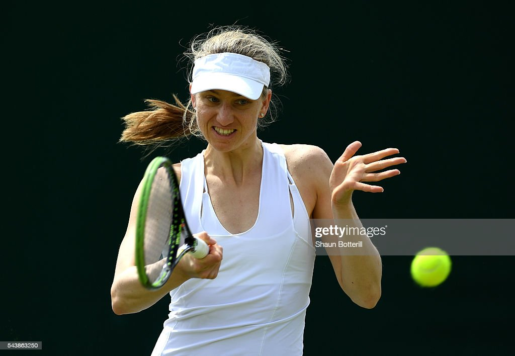 <a gi-track='captionPersonalityLinkClicked' href=/galleries/search?phrase=Mona+Barthel&family=editorial&specificpeople=7794496 ng-click='$event.stopPropagation()'>Mona Barthel</a> of Germany plays a forehand during the Ladies Singles second round match against Kiki Bertens of the Netherlands on day four of the Wimbledon Lawn Tennis Championships at the All England Lawn Tennis and Croquet Club on June 30, 2016 in London, England.