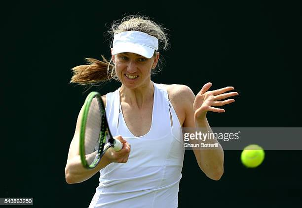 Mona Barthel of Germany plays a forehand during the Ladies Singles second round match against Kiki Bertens of the Netherlands on day four of the...