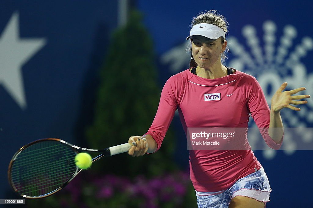 <a gi-track='captionPersonalityLinkClicked' href=/galleries/search?phrase=Mona+Barthel&family=editorial&specificpeople=7794496 ng-click='$event.stopPropagation()'>Mona Barthel</a> of Germany plays a forehand in her first round match against Ashleigh Barty of Australia during day four of the Hobart International at Domain Tennis Centre on January 7, 2013 in Hobart, Australia.