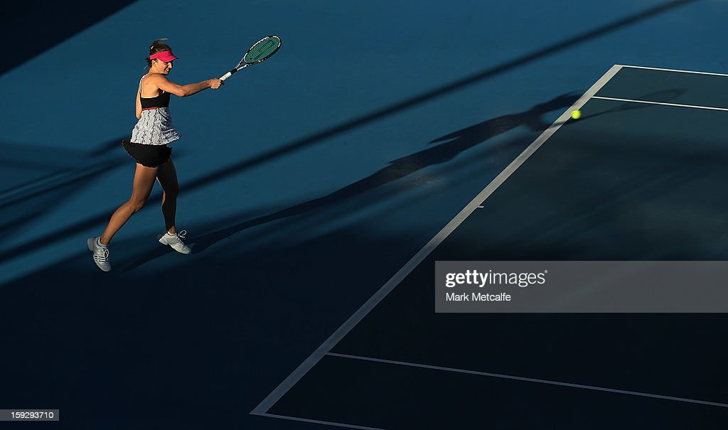 <a gi-track='captionPersonalityLinkClicked' href=/galleries/search?phrase=Mona+Barthel&family=editorial&specificpeople=7794496 ng-click='$event.stopPropagation()'>Mona Barthel</a> of Germany plays a forehand in her semi final match against Kirsten Flipkens of Belgium during day eight of the Hobart International at Domain Tennis Centre on January 11, 2013 in Hobart, Australia.