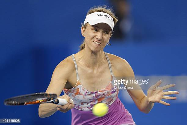 Mona Barthel of Germany returns a shot against Agnieszka Radwanska of Poland during the Women's singles Second round match on day three of the 2015...