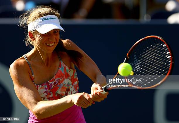 Mona Barthel of Germany returns a shot to Varvara Lepchenko of the United States during their Women's Singles Third Round match on Day Six of the...