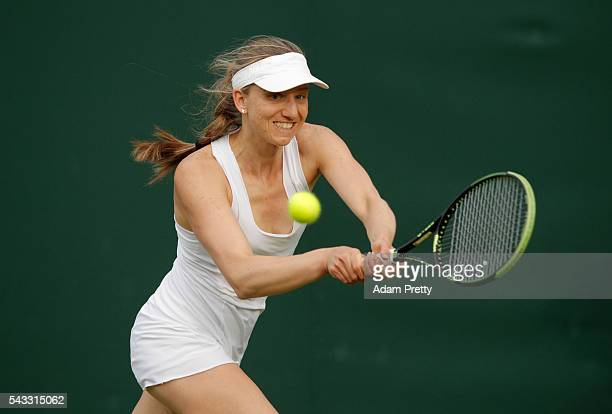 Mona Barthel of Germnay plays a backhand shot during the Ladies Singles first round match against Danka Kovinic of Montenegro on day one of the...