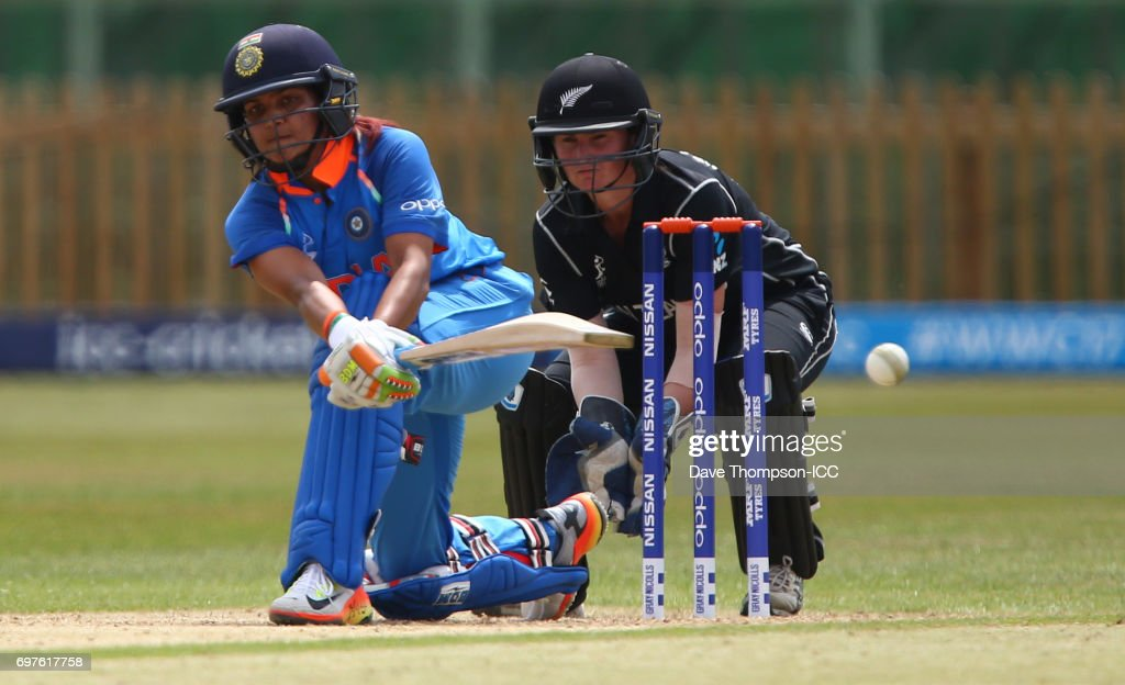 Mona Meshram of India plays a shot in front of New Zealand wicket keeper Katey Martin during the ICC Women's World Cup warm up match between India and New Zealand at The County Ground on June 19, 2017 in Derby, England.