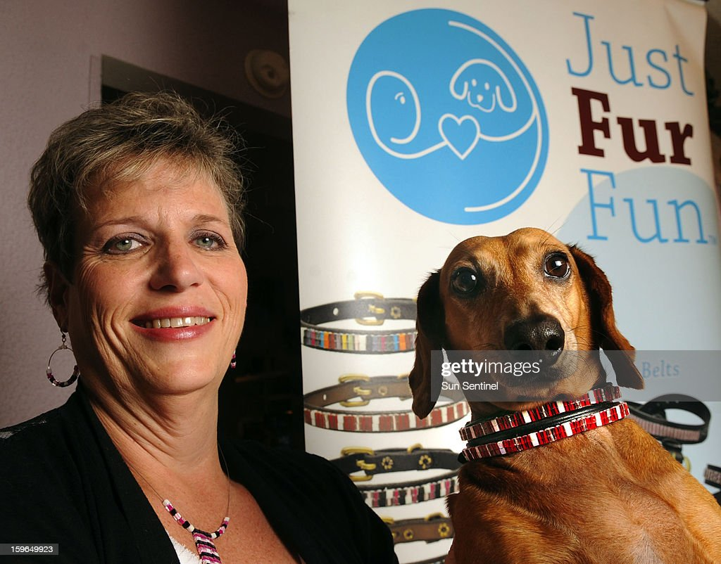 Mona Straub, founder of Just Fur Fun pet accessories in Boca Raton, Florida, and her dog, Nathan, who is wearing one of her creations.