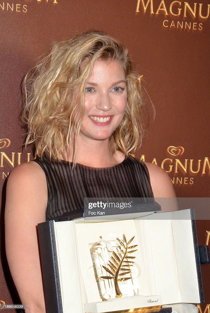 Mona Walravens poses with the Abdellatif Kechiche golden palm during La Vie D'Adele Palme d'Or Party At The Magnum Cannes Plage - The 66th Annual Cannes Film Festival on May 26, 2013 in Cannes, France.