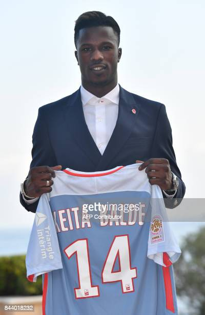 AS Monaco football club's newly recruited Spanish forward Keita Balde poses with his new jersey after a press conference on September 7 2017 in...