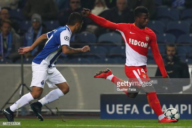 Monaco forward Keita Balde from Senegal with FC Porto forward Jesus Corona from Mexico in action during the UEFA Champions League match between FC...