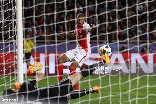 Monaco forward Kylian Mbappe shoots the ball and Juventus goalkeeper Gianluigi Buffon dives for the ball during the Uefa Champions League semi finals...
