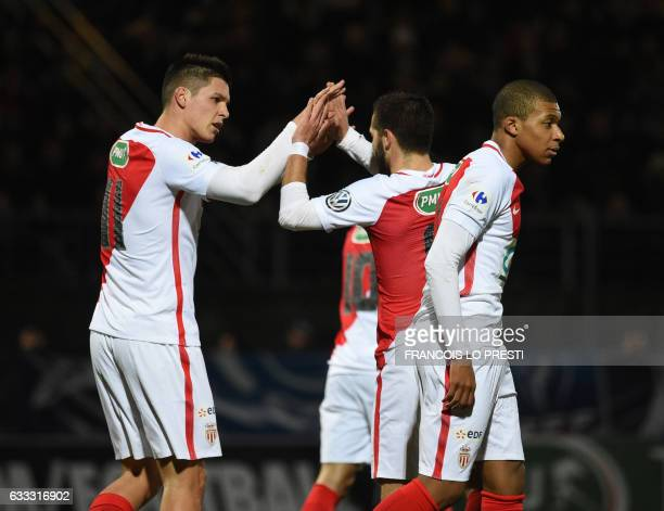 Monaco Guido Marcelo Carrillo is congratulated by teamates after scoring a goal during the French Cup football match between Chambly and Monaco on...