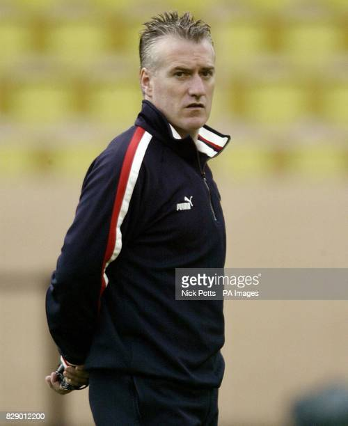 AS Monaco manager Didier Deschamps watches his team during a training session at the Louis II Stadium in Monaco France ahead of their UEFA Champions...