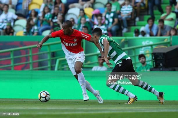 Monaco midfielder Fabinho from Brasil tries to escape Sporting CP midfielder Rodrigo Battaglia from Argentina during the Friendly match between...