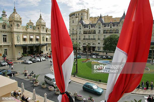 National redandwhite banners fly at halfmast above the Casino square 13 April 2005 in Monaco two days before the funeral of Prince Rainier III of...