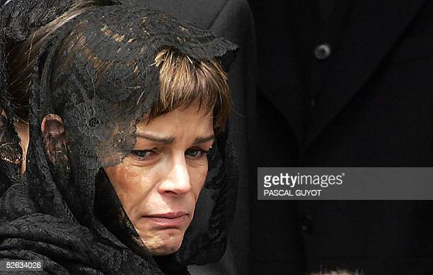 Princess Stephanie cries as she leaves the 19th cathedral after attending the funeral mass of their father late Prince Rainier III celebrated by...