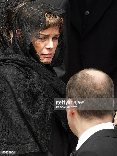 Princess Stephanie looks at her brother Prince Albert as they leave the 19th cathedral after attending the funeral mass of their father late Prince...