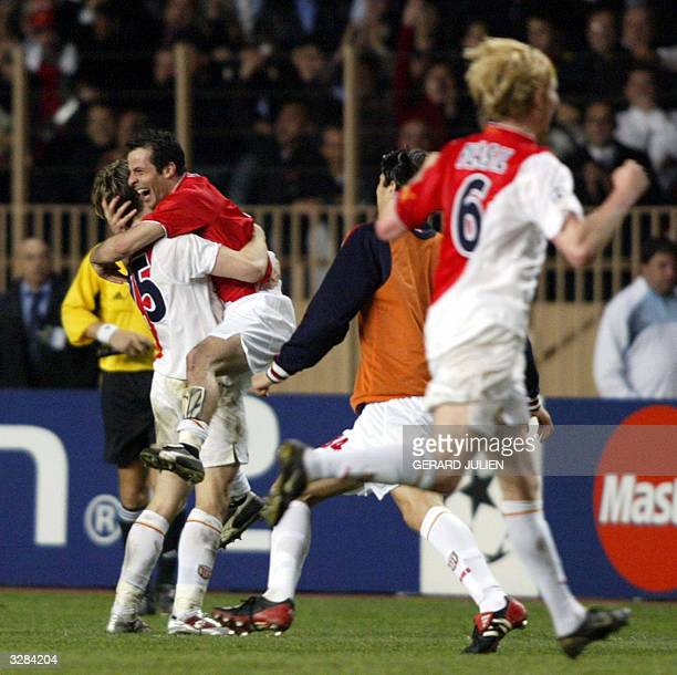 Monaco teammates jubilate after winning their Champions League quarterfinal second leg football match against Real Madrid 06 April 2004 at Louis II...