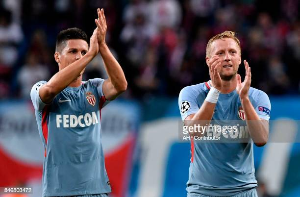 Monaco's Argentinian forward Guido Carrillo and Monaco's Polish defender Kamil Glik applaud their supporters after the UEFA Champions League group G...