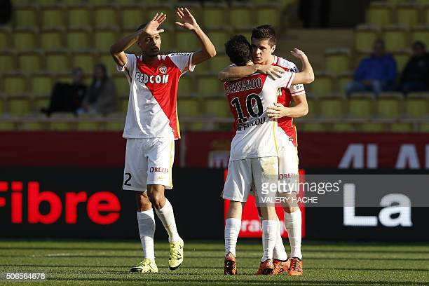 Monaco's Argentinian forward Guido Carrillo celebrates with Monaco's Portuguese midfielder Silva Bernardo and Monaco's Brazilian defender Fabinho...
